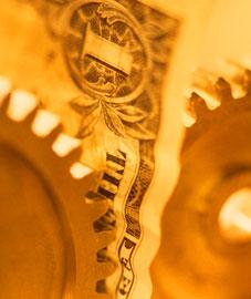 Dollar between gears, Fishbowl Blog