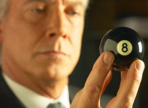 Businessman holding 8 ball, Fishbowl Blog