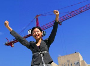 Businesswoman in front of crane, Fishbowl Blog