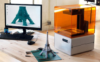 The Form 1 3D printer with a replica of the Eiffel Tower, QuickBooks Manufacturing Blog